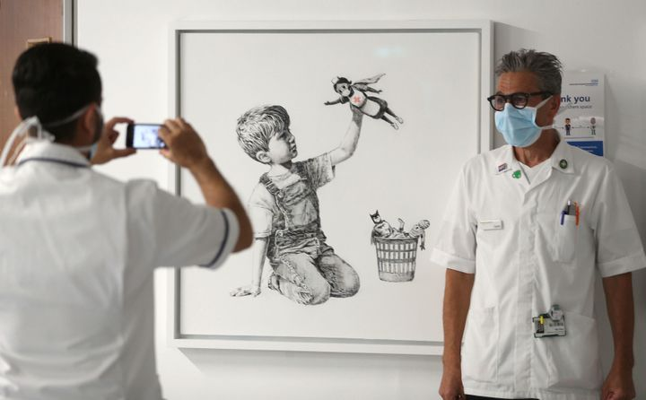 """<a href=""""https://www.huffpost.com/topic/banksy"""" target=""""_blank""""></a>Banksy honored health care workers on the front lines of"""
