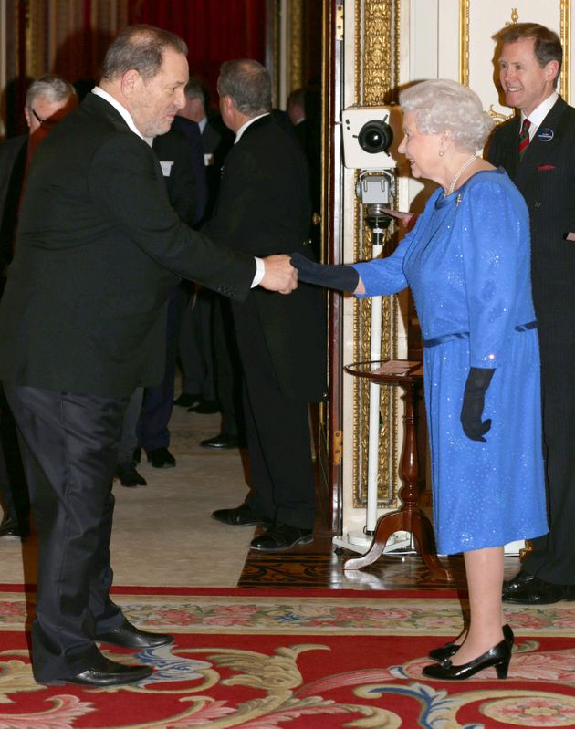 Queen Elizabeth II meets Harvey Weinstein during the Dramatic Arts reception at Buckingham Palace on February 17, 2014 in London.