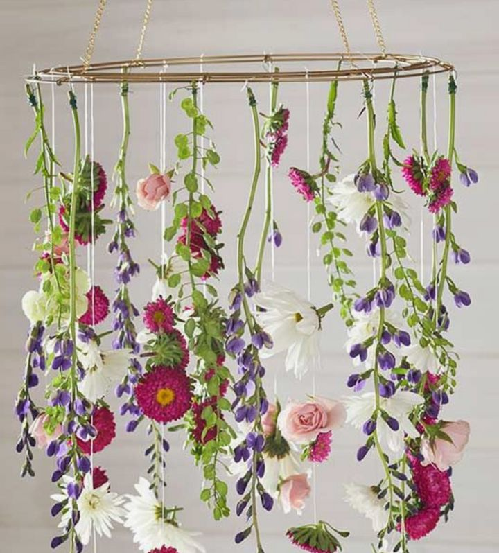 Use fresh  flowers and dollar store greenery to create this hanging arrangement.
