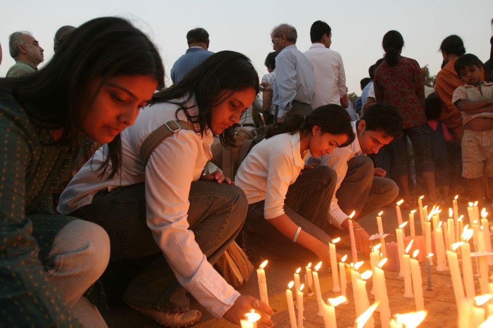 INDIA - MARCH 04:  People protest against Jessica Lal case verdict in which main accused Manu Sharma along with nine others was acquitted from the charge of murder at the India Gate, New Delhi, by lighting candles.  (Photo by Arijit Sen/The The India Today Group via Getty Images)