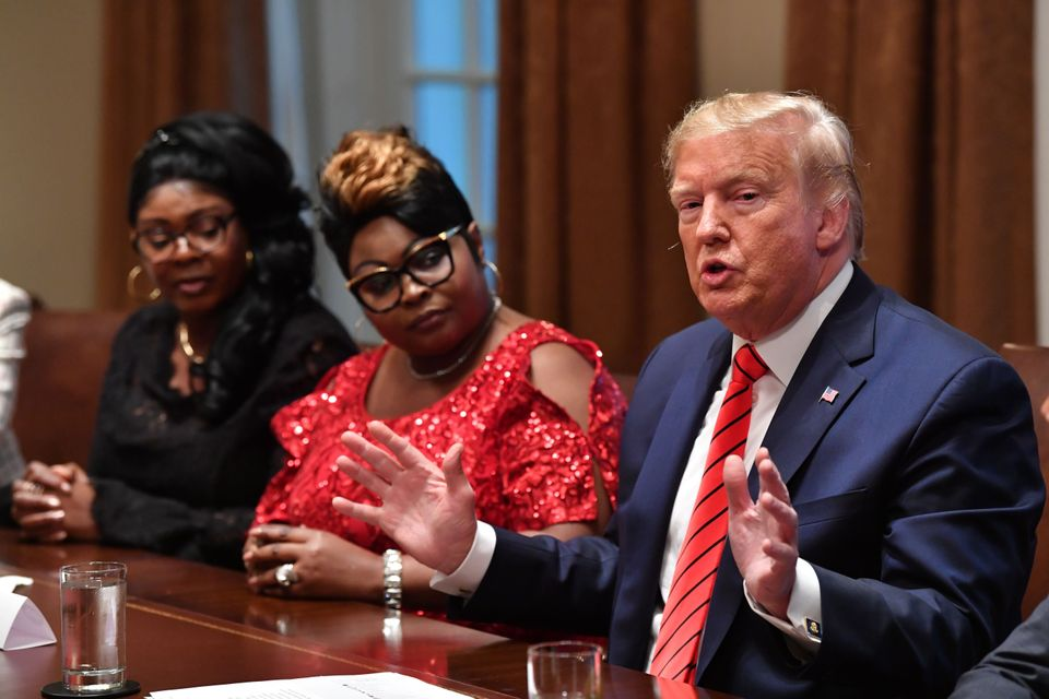 Trump speaks as social media personalities Lynnette Hardaway (L) and Rochelle Richardson (2-L), otherwise known as Diamond and Silk listen during a meeting.