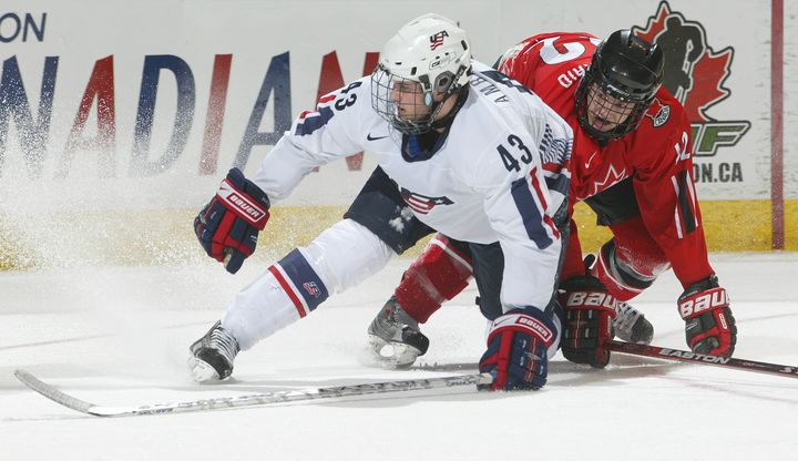 Team USA's Tyler Amburgey (No. 43) collided with Peter Holland of Team Ontario at the 2008 World Under 17 Challenge in Canada
