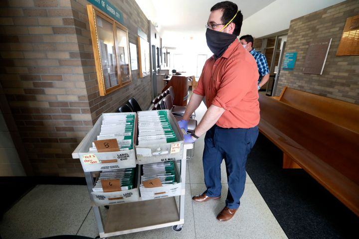 Michigan voters won't have to worry about their mailed absentee ballots (pictured above) being returned late after a judge ex