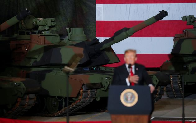 President Donald Trump speaks to workers in front of tanks on display at the Lima Army Tank Plant Joint...