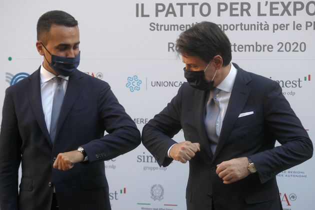 Italian Premier Giuseppe Conte, right, greets Foreign Minister Luigi Di Maio upon his arrival to the...