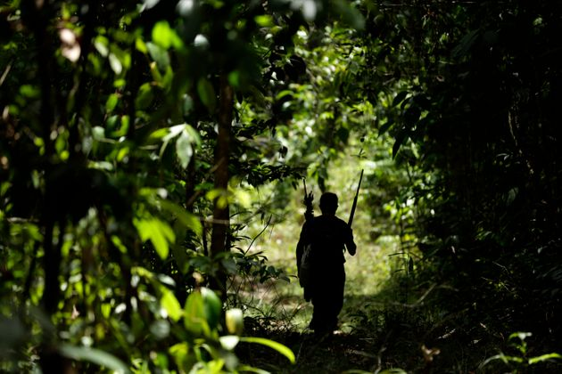 A Tenetehara Indigenous man patrols with the Ka'Azar, or Forest Owners, on the Alto Rio Guama reserve...
