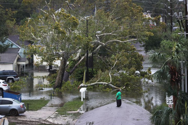 A person looks at a flooded neighborhood as Hurricane Sally passes through the area on Sep.16 in Pensacola, Florida.