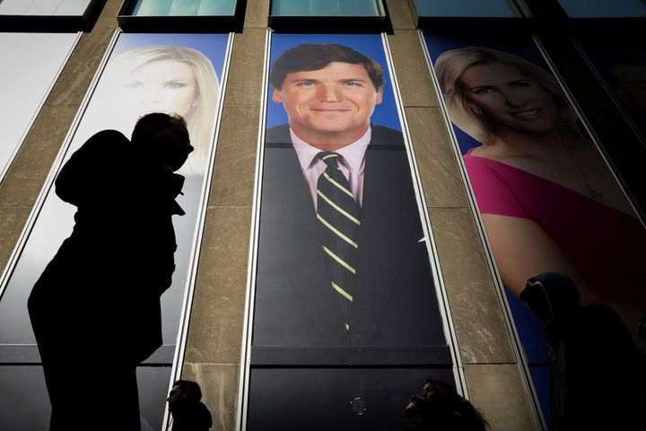 Fox News host Tucker Carlson, pictured on the News Corp building in New York, didn't mention Olivia Troye's condemnation of t