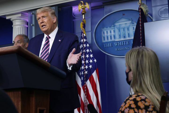 President Donald Trump holds a White House news conference Friday. A new HuffPost/YouGov poll indicates 51% of Americans disa