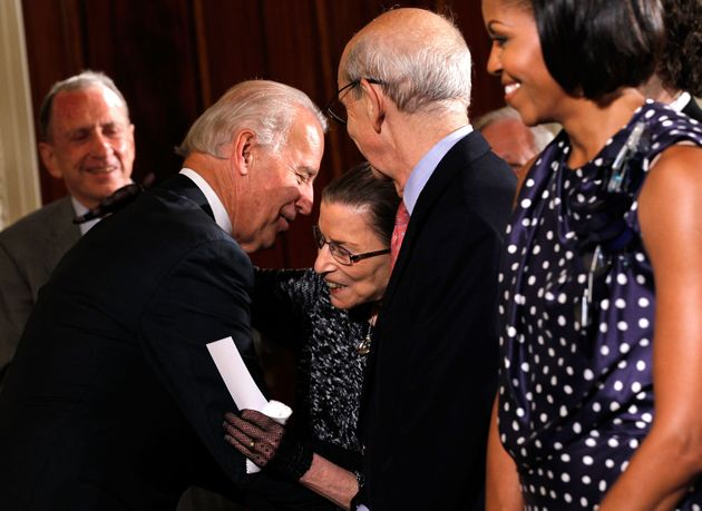 Joe Biden, then the vice president, greets Supreme Justice Bader Ginsburg on May 27, 2010, in the East...