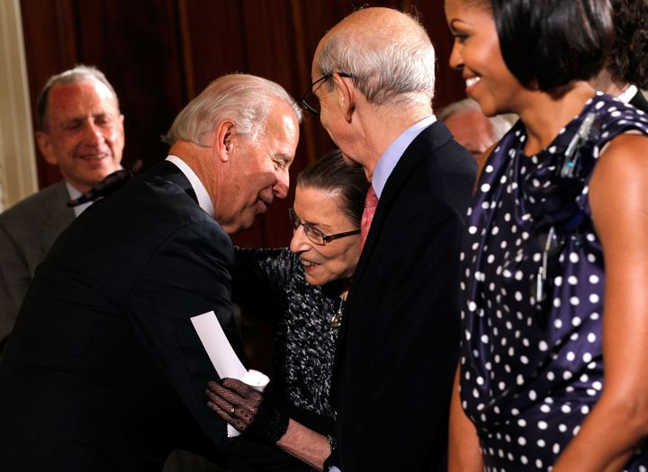 Joe Biden, then the vice president, greets Supreme Justice Bader Ginsburg on May 27, 2010, in the East Room of the White Hous