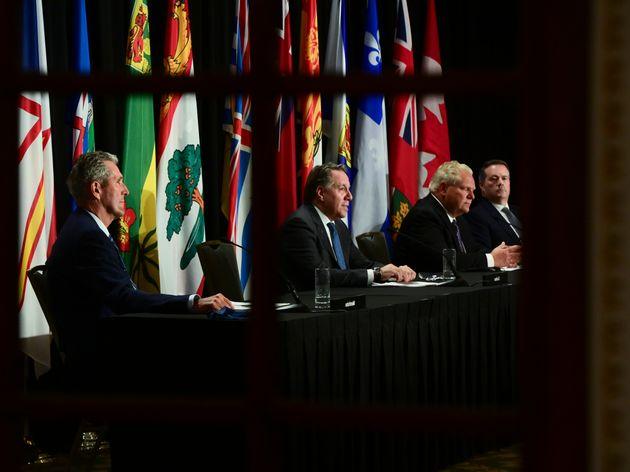 Quebec Premier Francois Legault, second left, speaks as Manitoba Premier Brian Pallister Ontario Premier...