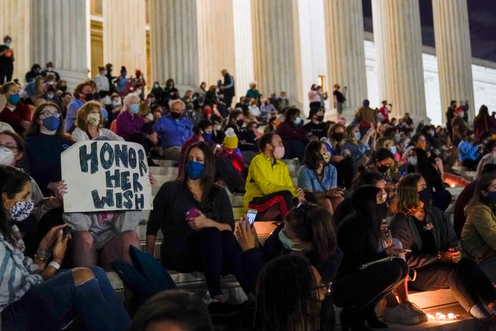 People gather at the Supreme Court on Friday night to honor Supreme Court Justice Ruth Bader Ginsburg, who died Friday night.