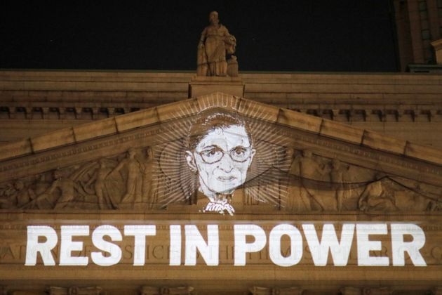 An image of Ruth Bader Ginsburg is projected onto the New York State Civil Supreme Court building in...