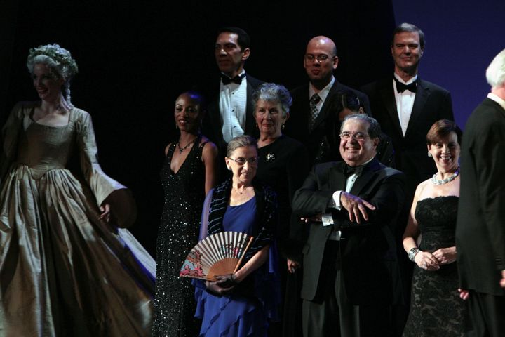Justice Ruth Bader Ginsburg, center, and Justice Antonin Scalia, center right, appear on stage on the opening night of the Wa