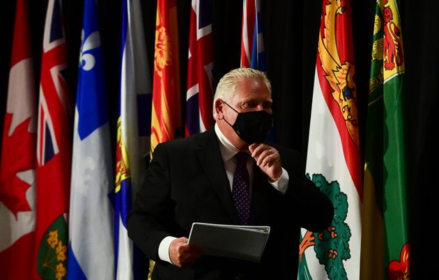 Ontario Premier Doug Ford leaves a press conference in Ottawa on