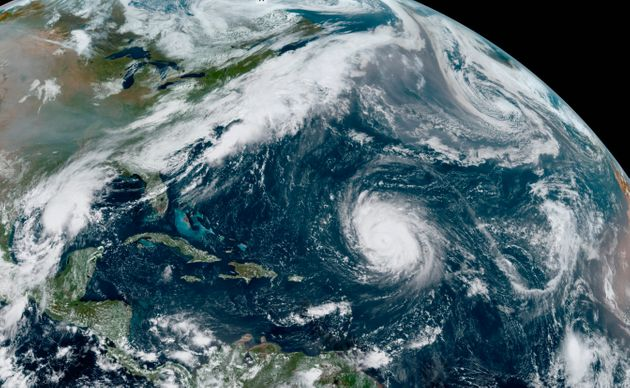 This GOES-16 GeoColor satellite image taken on Friday shows Hurricane Teddy, centre, in the Atlantic,...