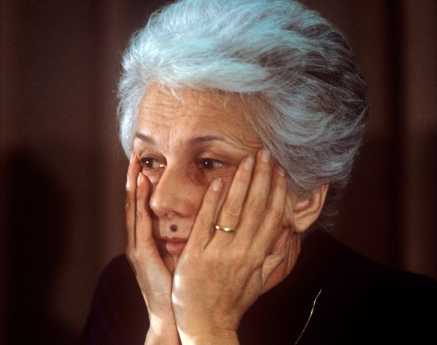 Portrait of thoughtful journalist and writer Rossana Rossanda resting her face in her hands; native of...