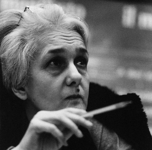 Italian MP Rossana Rossanda ponders while raising a pen in her right hand; the journalist and writer...
