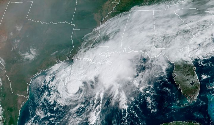 This GOES-16 GeoColor satellite image taken Saturday, Sept. 19, 2020, and provided by NOAA, shows Tropical Storm Beta, center, in the Gulf of Mexico. A hurricane watch is in effect Saturday for coastal Texas as Tropical Storm Beta gains strength. A storm surge watch and a tropical storm watch are also in effect for the area during an exceptionally busy Atlantic hurricane season. (NOAA via AP)