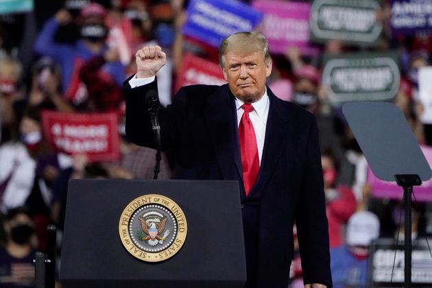 President Donald Trump wraps up his speech at a campaign rally at Fayetteville Regional Airport, Saturday,...