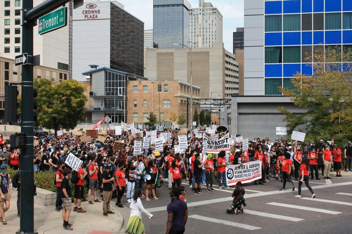 Protesters through downtown Denver toward government buildings during the Drop the Charges march and rally. (Photo by Madeleine Kelly/NurPhoto