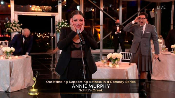 "Annie Murphy accepts the Emmy for Outstanding Supporting Actress in a Comedy Series for ""Schitt's Creek."""