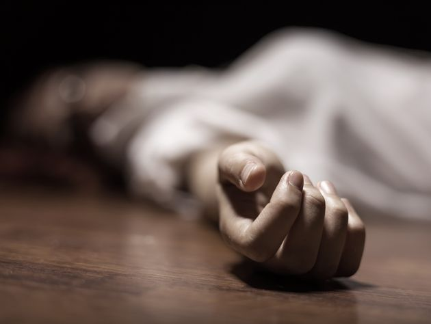 The dead woman's body. Focus on