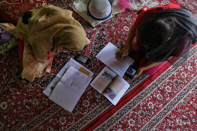 Students in Kashmir take Zoom classes at their home in Sopore Town of district Baramulla, Jammu and Kashmir,...