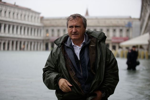 Venice's Mayor Luigi Brugnaro walks in a flooded St. Mark's Square in Venice, Italy, Friday, Nov.15,...