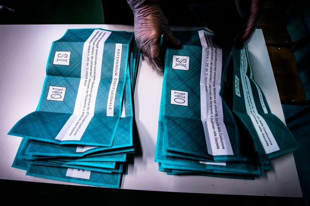 A polling official begins the counting of the ballots for the referendum vote in a polling station in...