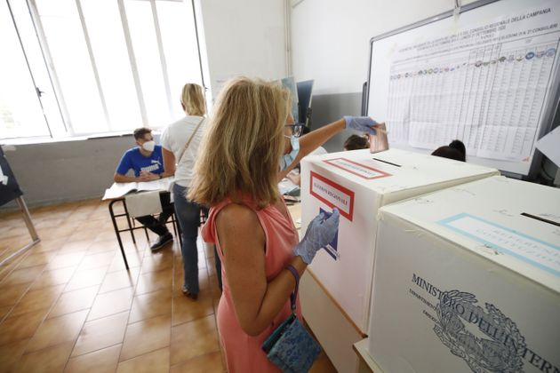 NAPLES , Sept. 20, 2020 -- A woman casts her vote at a polling station in Naples, Italy, on Sept. 20,...