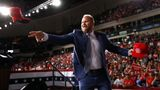 Brad Parscale, campaign manager for President Donald Trump, tosses a hat to supporters before Trump speaks at a campaign rally, Thursday, Aug. 15, 2019, in Manchester, N.H. (AP Photo/Patrick Semansky)