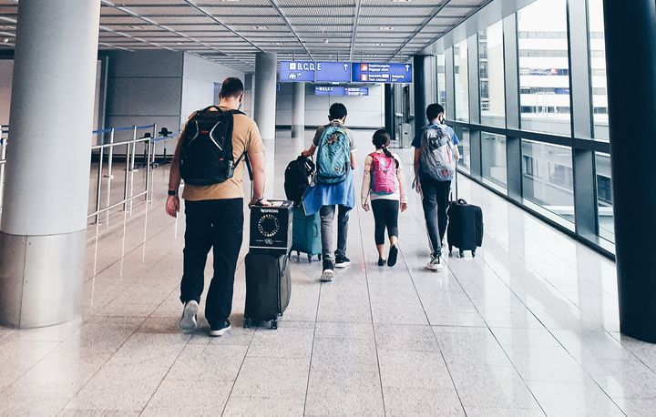The Nelson family navigate one of many airport stops on their two-week commute home from Saudi Arabia under Australia's stric