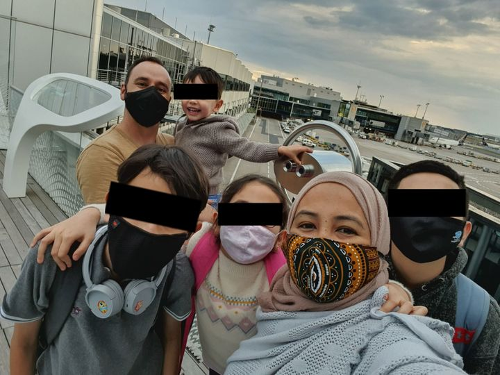 The Nelson family (above) was trapped inside Germany's Frankfurt am Main Airport after a transit policy oversight by a travel agent. This was their first taste of fresh air in four days. (The family asked that the children's faces be obscured.)