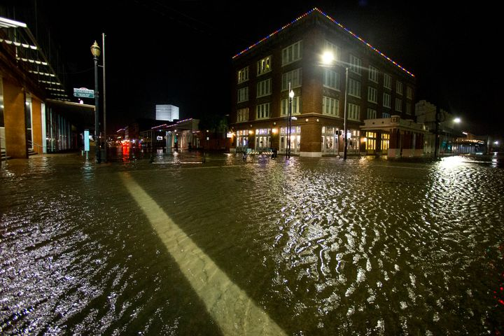 Water rises from the storm surge of Tropical Storm Beta in Galveston, Texas on Monday night.