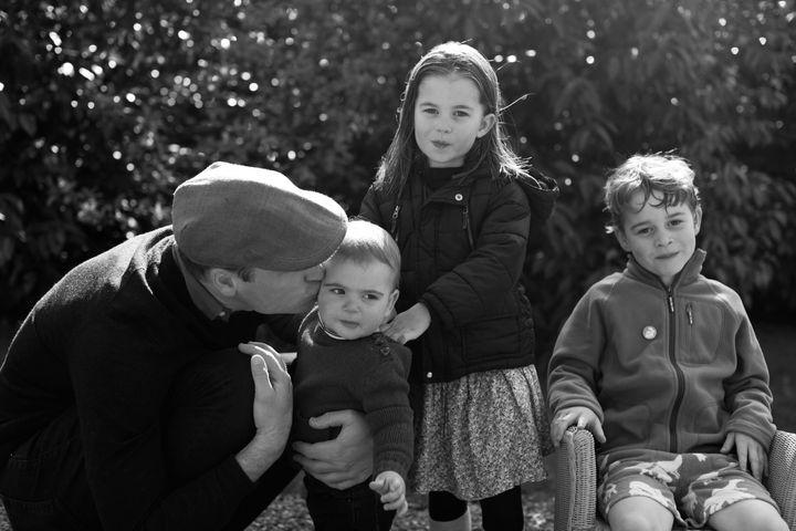 William with his three children.