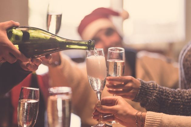 Cropped image of people toasting with champagne celebrating