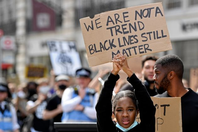 A protester holds up a sign during a Black Lives Matter march in London in