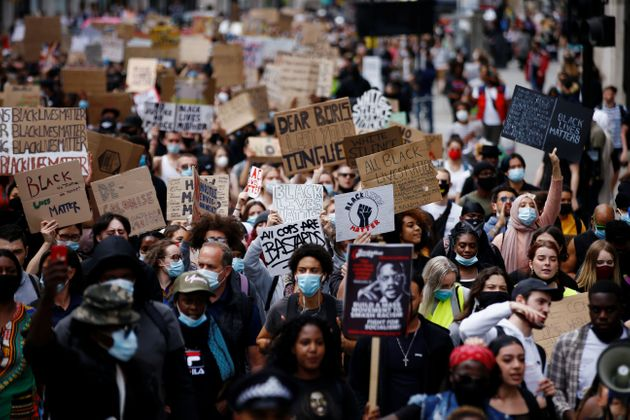 People march to Westminster during a Black Lives Matter protest following the death of George Floyd in...