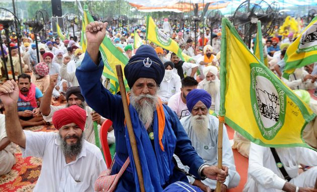 Farmers raise slogans during a protest in Punjab against the Electricity Amendment Bill 2020 and the...
