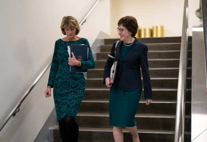 GOP Sens. Lisa Murkowski (Alaska) and Susan Collins (Maine) walk together following a vote at the Capitol in February. S