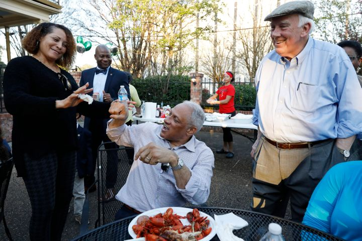 Mike Espy (center), the Democratic nominee for a Senate seat in Mississippi, attempts to fist bump at a crawfish boil in Jack