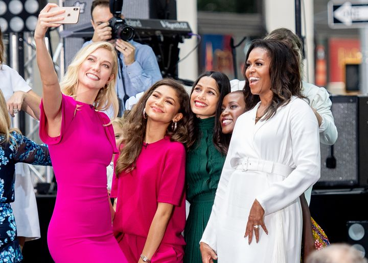 Zendaya and Michelle Obama pose for a selfie with Karlie Kloss and Freida Pinto in 2018.