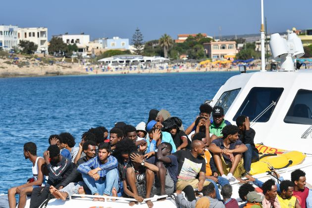 Migrants from Tunisia and Lybia arrive onboard of an Italian Guardia Costiera (Coast Guard) boat in the...