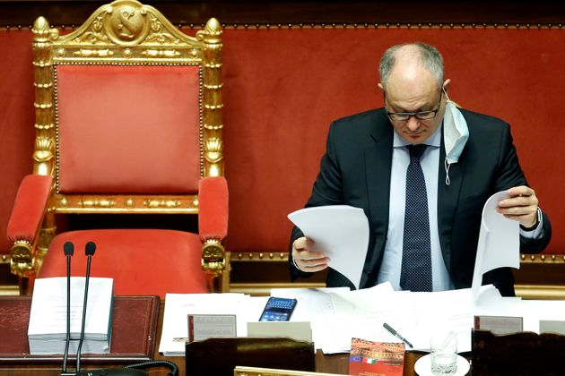 The Italian Minister of Economy Roberto Gualtieri at the Senate reading finance documents during the...