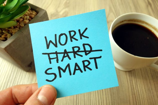 Work smart text - motivational reminder handwritten on sticky