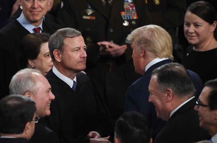Donald Trump greets Supreme Court Chief Justice John Roberts as the president arrives to deliver the State of the Union addre
