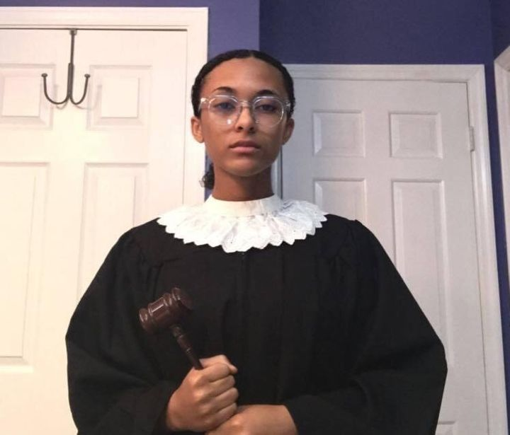 Leyla Fern King dresses up as Justice Ruth Bader Ginsburg, complete with a white collar and gavel.