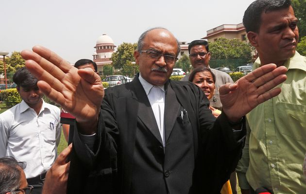 Prashant Bhushan, a senior lawyer, speaks with the media in New